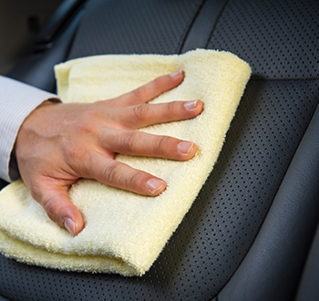 Person Hand Washing Car With Yellow Towel (1)