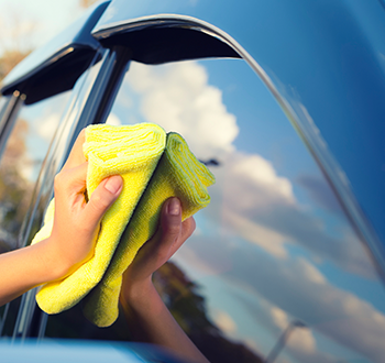 Person Shining A Car With A Towel