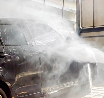 Black Car Getting Sprayed With Water (1)